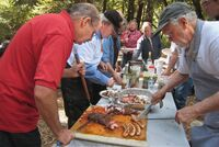 Terry-and-Ken-carving-the-meat.jpg